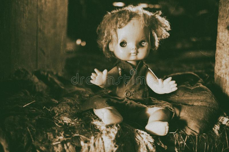 Scary horror plastic doll without eyes. Ghost mystic doll smiling. Scary horror plastic doll without eyes royalty free stock image