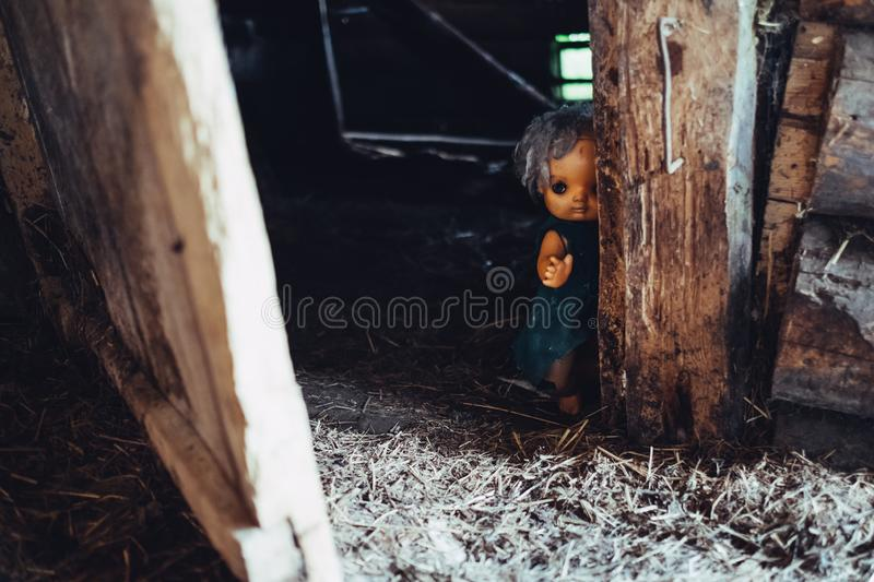 Scary horror plastic doll without eyes. Ghost mystic doll smiling. Scary horror plastic doll without eyes royalty free stock photography