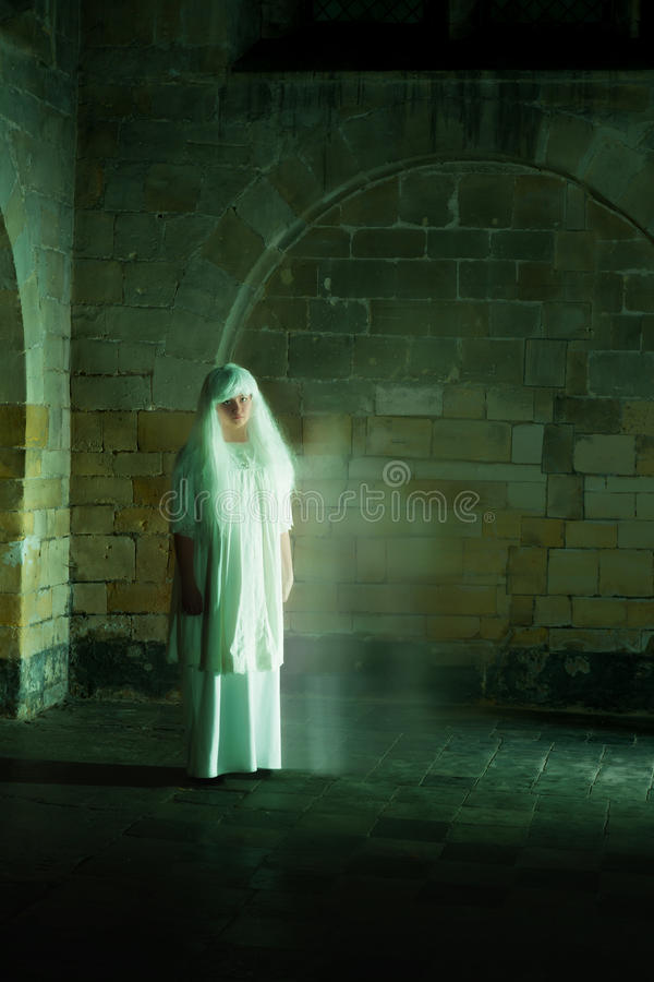 Ghost at night. Night scene in a medieval castle with a woman ghost royalty free stock images