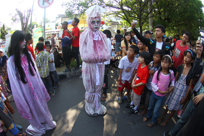 Ghost. People taking photo of actress performing as ghost in solo, central java, indonesia stock image