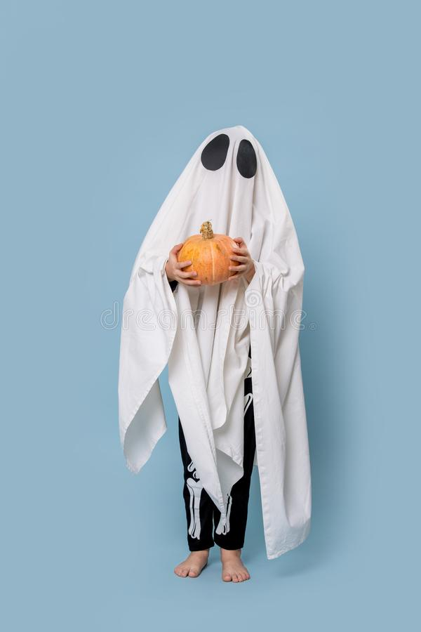 Ghost with a pumpkin in his hands royalty free stock images