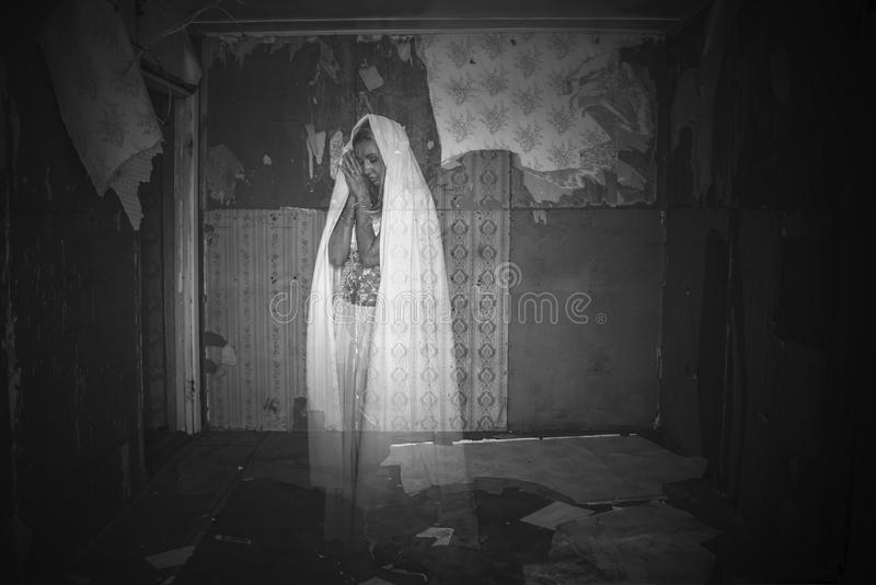 Ghost in a room. Ghost in an abandoned room royalty free stock images
