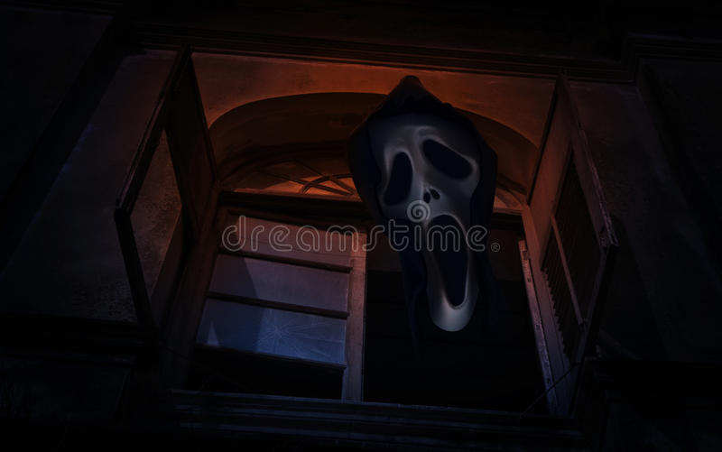 Ghost scream over old ancient window castle, Spooky background,. Halloween concept royalty free stock photo