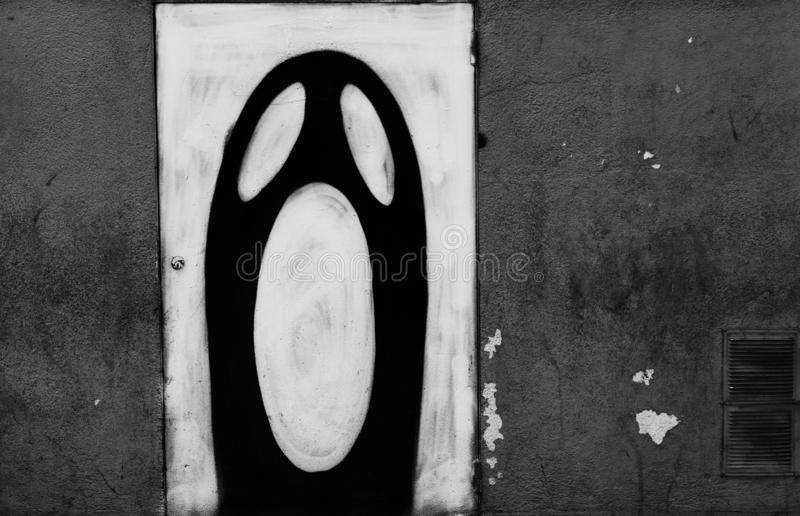 Ghost shape on the street. Shot in black and white  detail on the facade of this historic building representing some character, animal or plant, set in Eixample royalty free stock photo