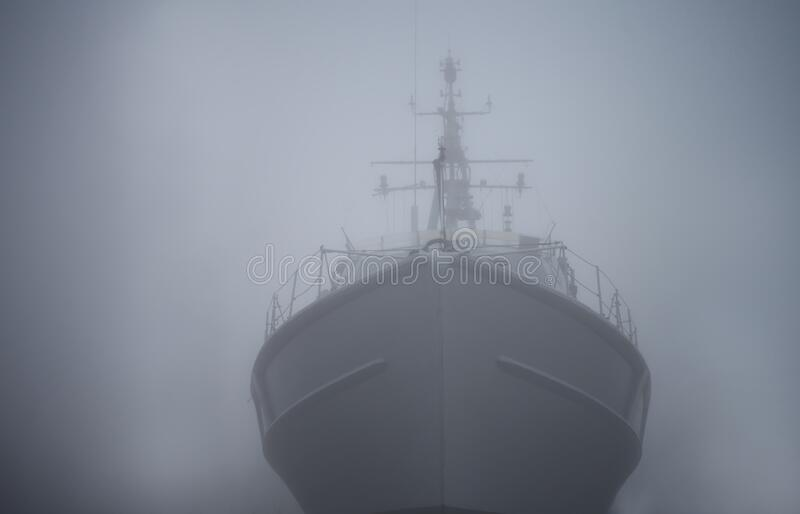 Ghost ship. Warship in the fog or mist as a flying Dutchman. Gray color. Mystery concept. Pirate Code, doomed vessel rise from the. Sea, spreading terror across royalty free stock photos