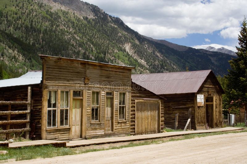 Ghost Town. A pair of old, abandoned buildings stand in St. Elmo, a ghost town in the Colorado Rocky Mountains. St. Elmo is one of Colorado's best-preserved stock photo