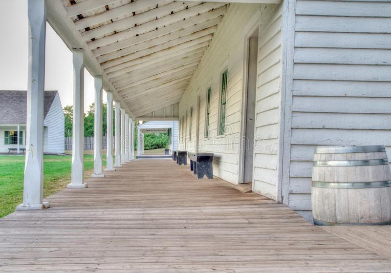 Ghost Town. Covered porch of ninteenth century military outpost. Fort Wilkins State Park. Copper Harbor, Michigan stock photos