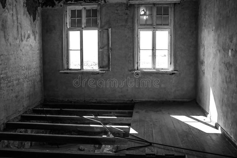 Ghost town. Kolmanskop, ghost town in the area of the diamond mines, Namibia, interior of a house, black and white royalty free stock photo