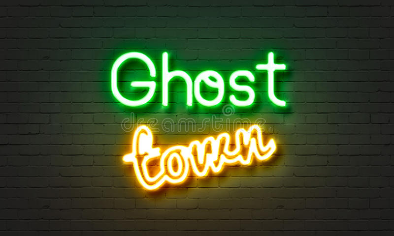 Ghost town neon sign on brick wall background. stock images