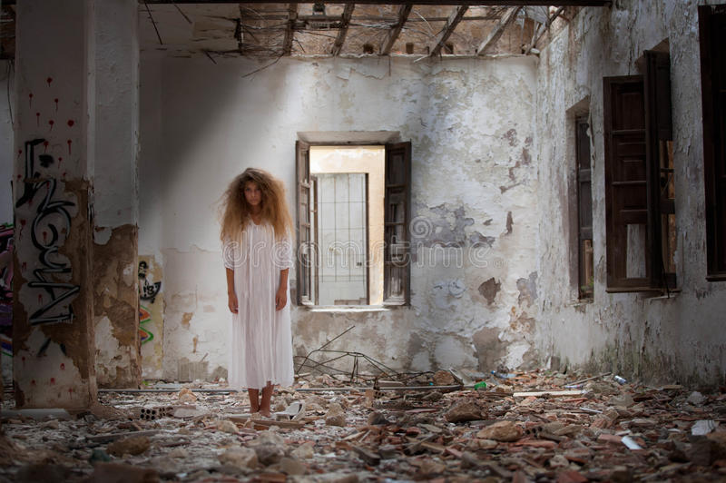 Ghost woman in abandoned house royalty free stock photography