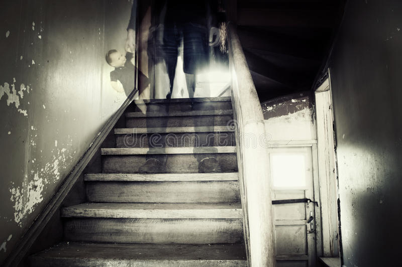 Ghostly figure in a hounted house stock photo