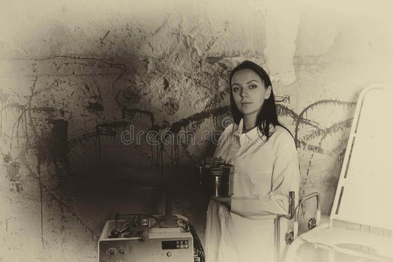 Ghostly monochrome image of a woman holding an aluminum box in f royalty free stock photography