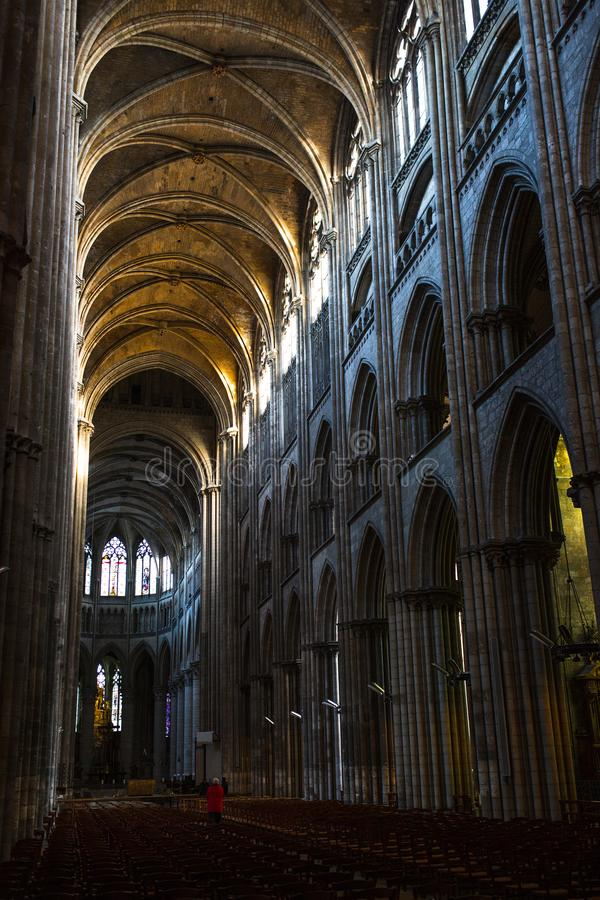 Rouen Saint Cathedrale interior view with sunlights. Ghotic church interior view with sunlights royalty free stock photo