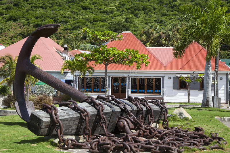 Giant anchor at Gustavia waterfront at St Barts royalty free stock photography