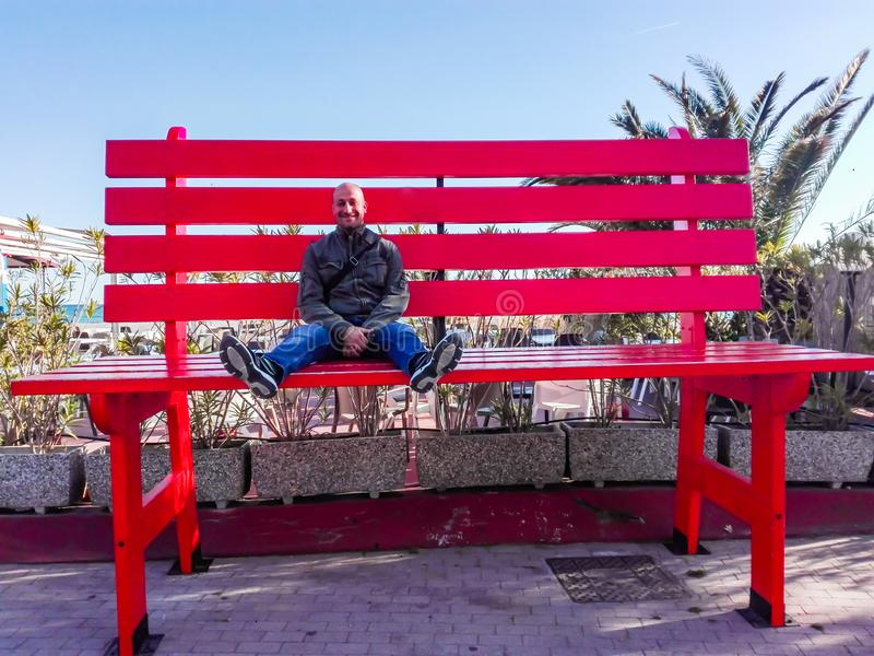 Giant bench or little man? royalty free stock photos