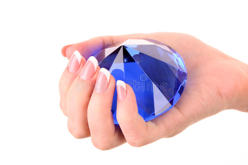 Giant Blue Diamond In Hand Isolated Stock Images