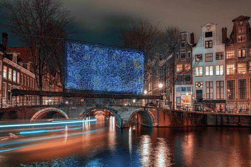 Giant blue light object placed on a bridge over the Herengracht in the old town of Amsterdam royalty free stock photos