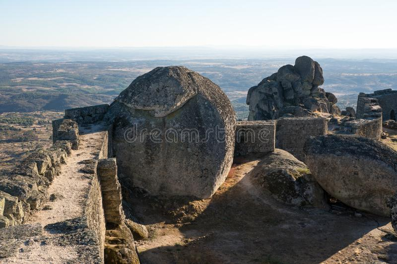 Giant boulder next to the historic castle in Monsanto royalty free stock image