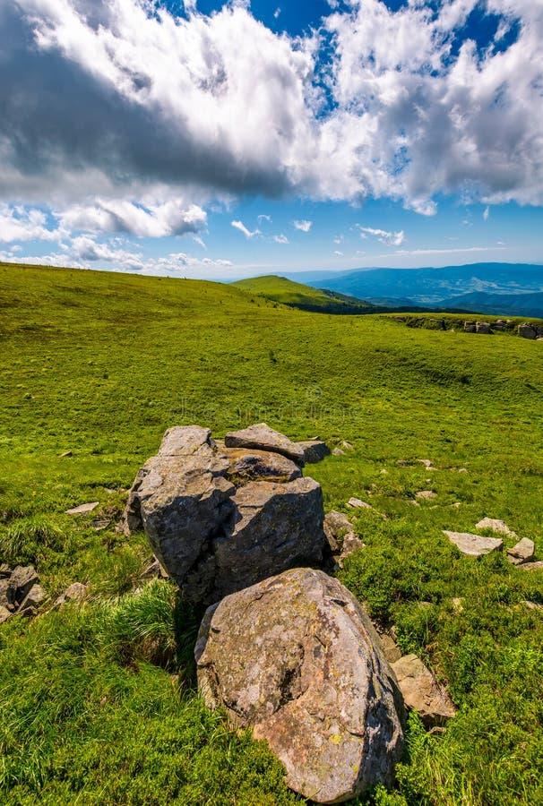 Giant boulders on grassy slopes of Polonina Runa royalty free stock photography