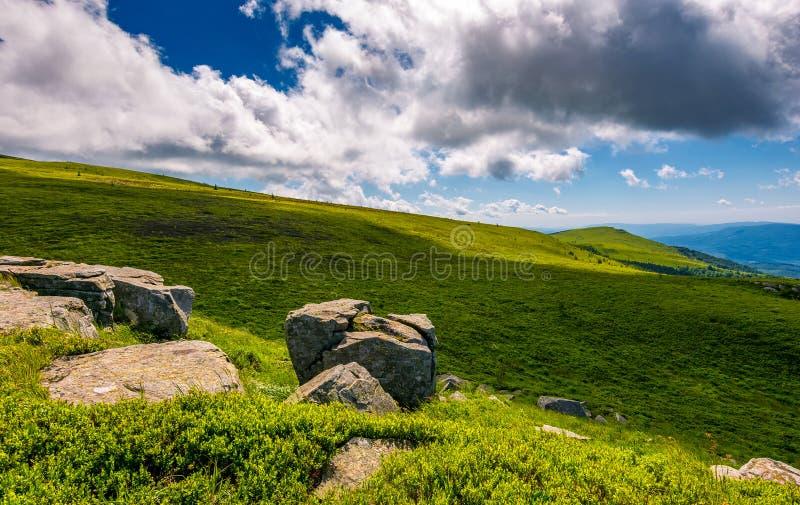 Giant boulders on grassy slopes of Polonina Runa royalty free stock photo