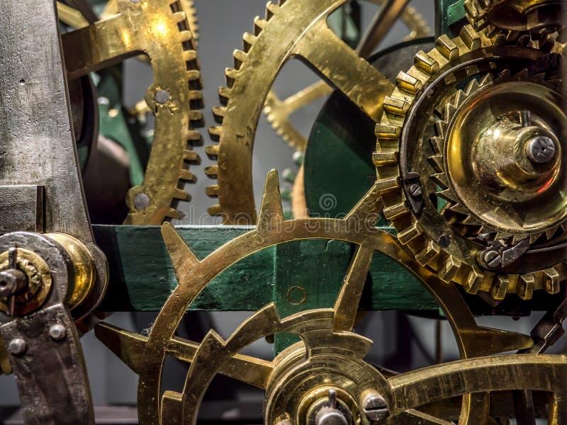 Giant brass clock mechanism. Giant brass clock cogwheel mechanism stock photo