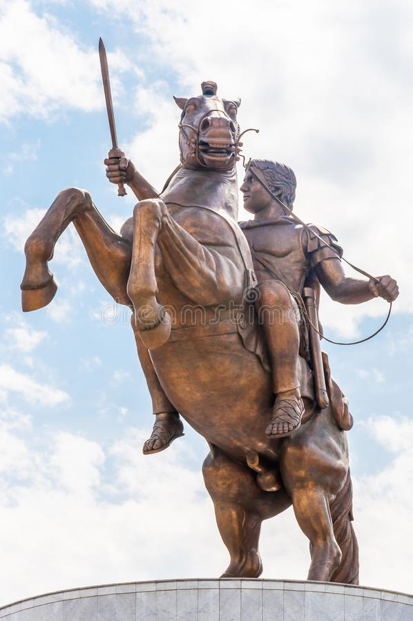 A giant bronze statue of the ancient warrior king with sword on the horse that standing up on its hind legs. The statue of stock photography
