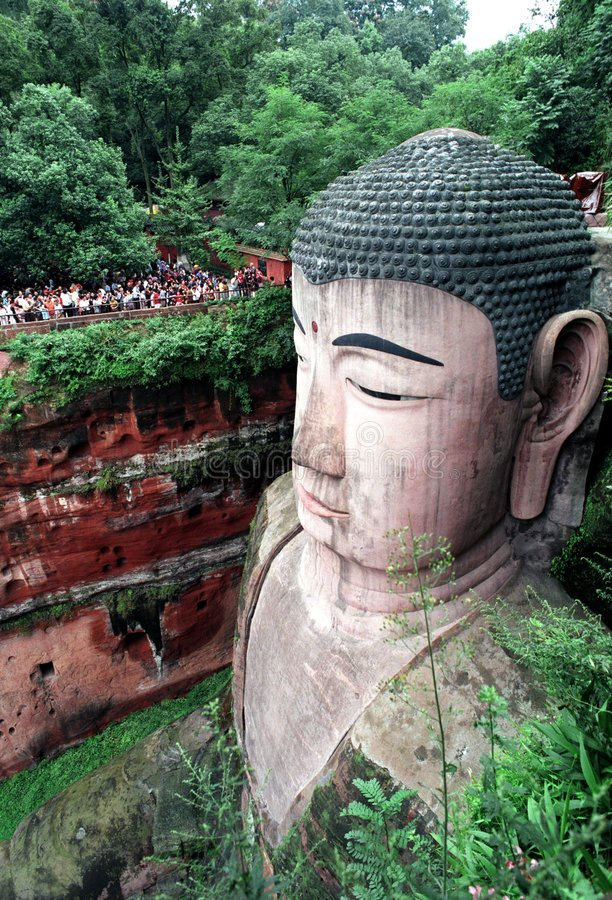 Giant Buddha. The Giant Buddha statue in Leshan City, Sichuan Province, China,rests his feet where three rivers——the Minjiang, Qingyi and Dadu stock photos