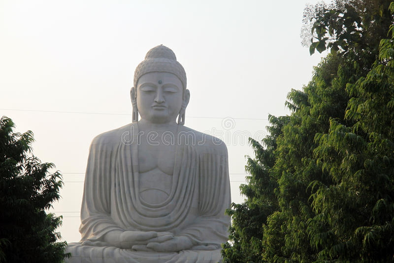 Giant Buddha at Bodh Gaya, India. A giant stone Buddha gazes over the grounds of a temple complex in Bodh Gaya, Bihar, India where the Buddha did most of his stock photos