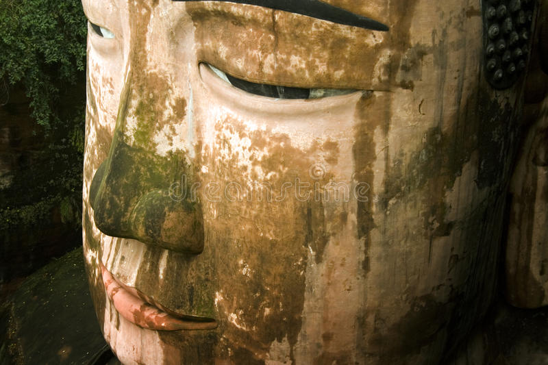 Giant buddha's face in leshan, sichuan, china. The biggest buddha statue in the world, sculpted in the mountains in leshan, sichuan, south china stock photography