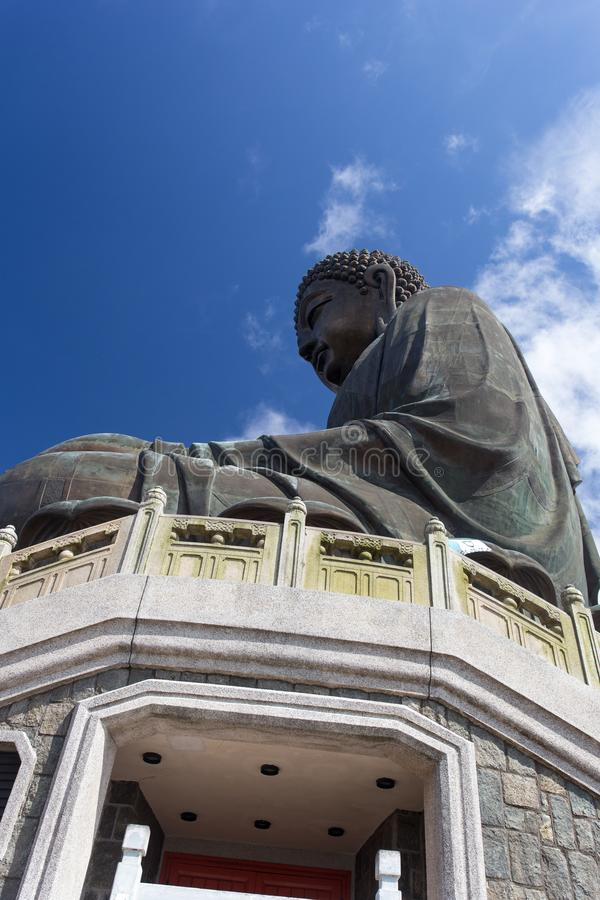 Giant Buddha Statue in Hong Kong. The giant Buddha statue at Ngong Ping, Hong Kong, against the backdrop of the blue sky, from bottom up perspective royalty free stock photo