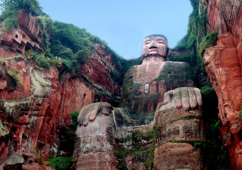 Giant Buddha statue near the city of Leshan in Sichuan province in China. He Leshan Giant Buddha is a 71-meter, 233 ft tall stone statue. Built between 713 and royalty free stock images