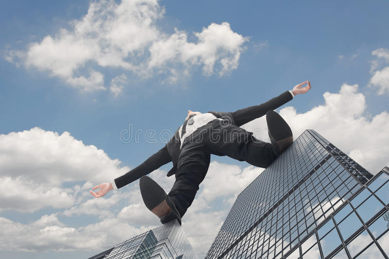 Giant businessman. Stand on roof of skyscraper against sky. Concept of challenge, growth, idea, big etc stock photography