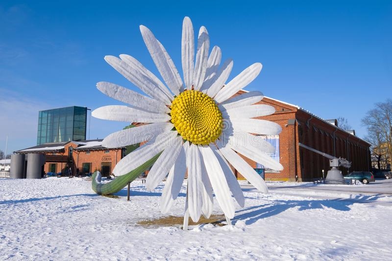 A giant chamomile flower near the Forum Marinum exhibition center on a sunny winter day. Turku, Finland. TURKU, FINLAND - FEBRUARY 23, 2018: A giant chamomile royalty free stock photo