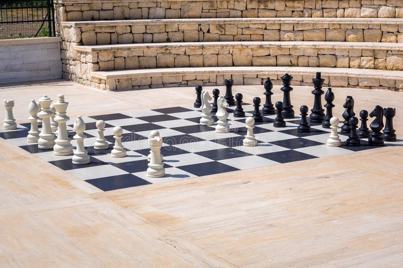 Giant chessboard to play outdoor royalty free stock photography