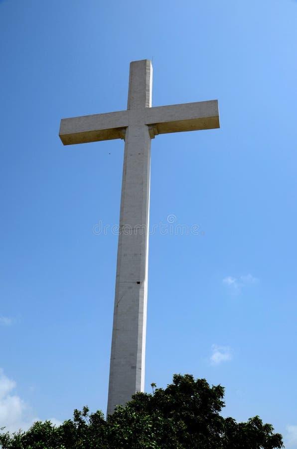 Giant Christian Cross at Gora Qabaristan cemetery Karachi Pakistan. Karachi, Pakistan - September 9, 2016: A 43 meters tall Christian cross near the entrance to stock photos