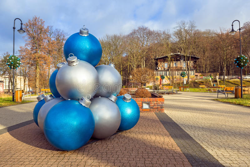 Giant Christmas baubles decoration in the park of Trzebnica. Poland stock photography