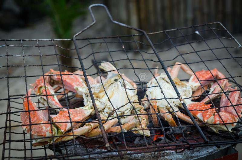 Giant crab beeing grilled on simple coal fire barbecue at Tokeh Beach, Sierra Leone, Africa royalty free stock photography