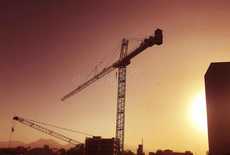 Giant crane over construction site royalty free stock photo
