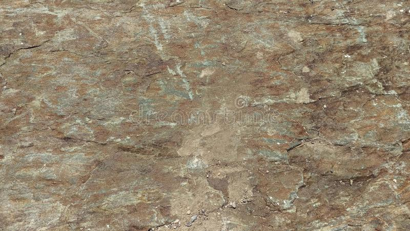 Green and Bronze Slate Boulder royalty free stock images