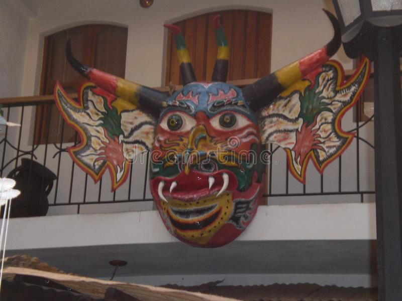 Giant devil mask with bright and striking colors typical of Venezuela from a tradition called `Yare devils`. Craft exhibition royalty free stock photos