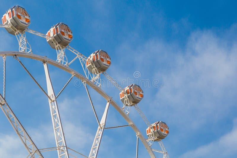 Giant ferris wheel Valencia Spain. Giant white ferris wheel behind the Port Authority building in Valencia Spain stock photography