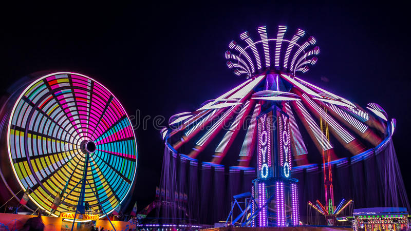 Giant Ferris Wheel and Yo-Yo Amusement ride stock photo