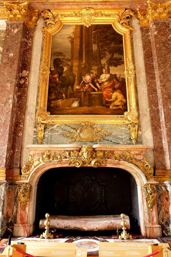 Giant Fireplace and Painting in the Salon of Hercules, Versailles, France royalty free stock photos