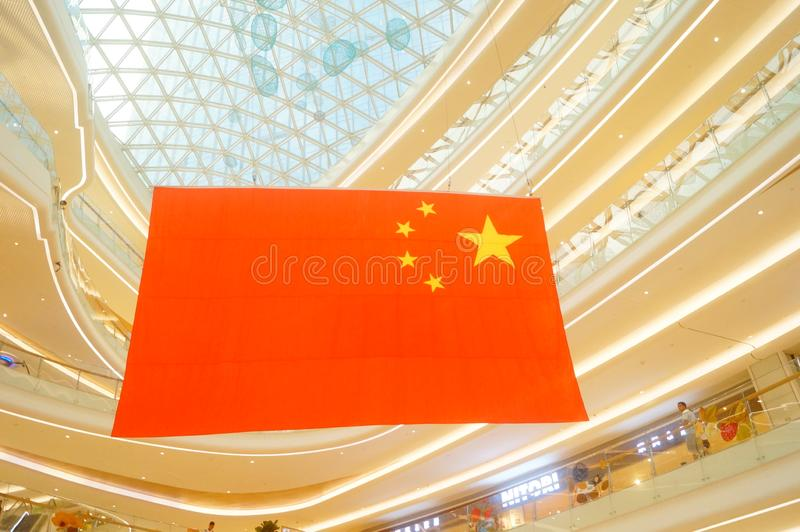 Shenzhen, China: a giant five-star red flag hangs in a shopping mall to greet National Day stock photos
