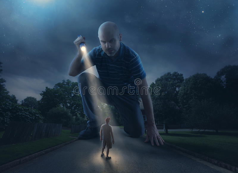 Giant with flashlight. A huge giant discovers a person walking on the road