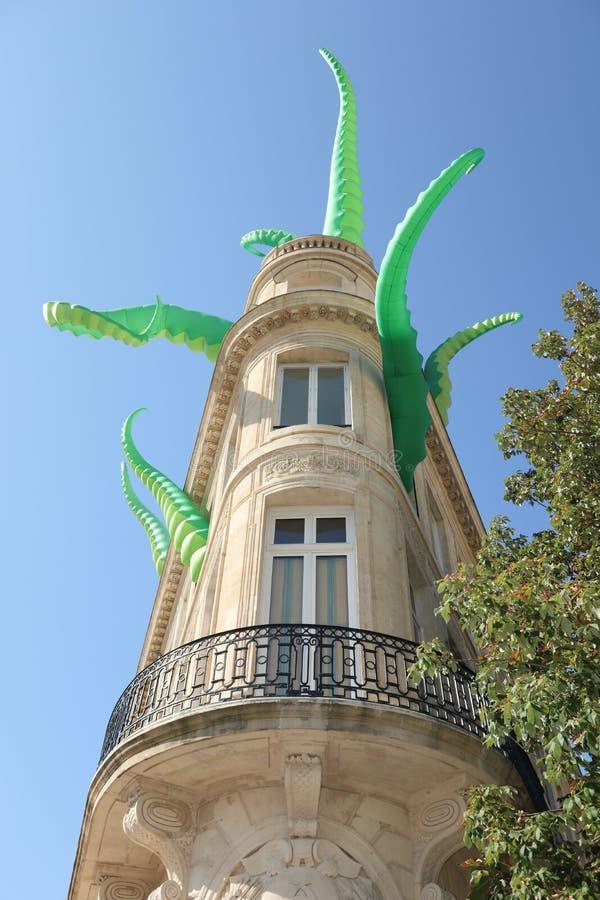 Giant fluorescent green alien tentacles burst out of buildings. A giant fluorescent green alien tentacles burst out of buildings stock images