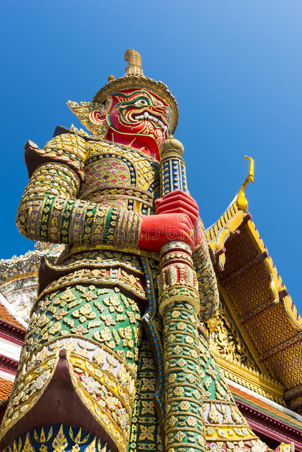 Giant in front of temple roof at Wat Phra keaw,Bangkok,Thailand royalty free stock photo