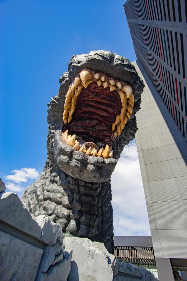 A Giant Godzilla in Tokyo that Overlooks at Shinjuku. The statue is housed in Hotel Gracery Shinjuku, and guests can go out on a viewing platform to get an up royalty free stock photography