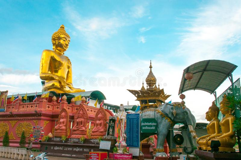 Giant Golden Buddha statue with blue sky Thailand royalty free stock photos