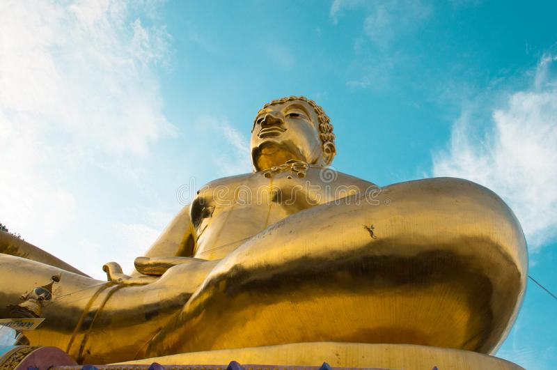 Giant Golden Buddha statue with blue sky Thailand royalty free stock photography